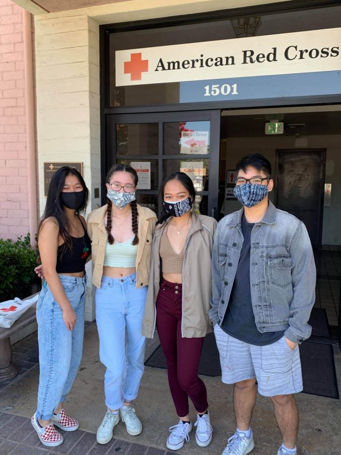 Sabrina Spatny, Lauren Hession, Victoria Pacis, and Earl Bumagat picking up packages for Online Leadership Development Camp in August at the Glendale Red Cross Chapter.