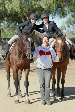 Mrs. Stafford poses with the former GHS equestrian team.