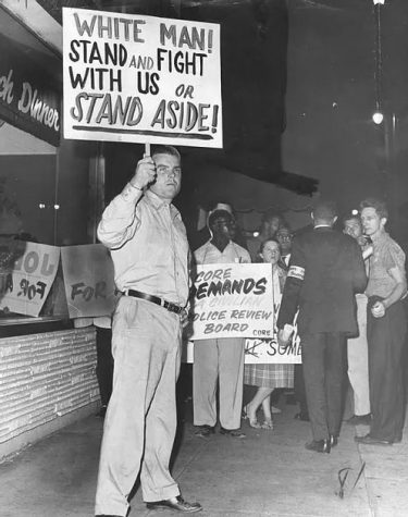 Robert Giles, a 28-year-old member of the American Nazi party, protests against civil rights advocates on August 29, 1963.