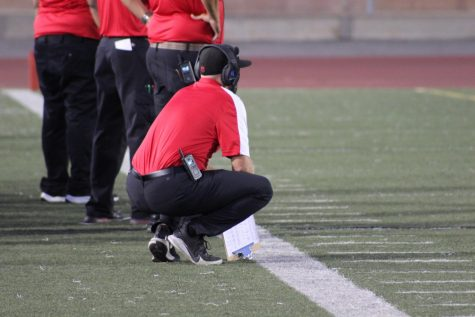 Coach Jacob Ochoa watches his team from the sidelines.